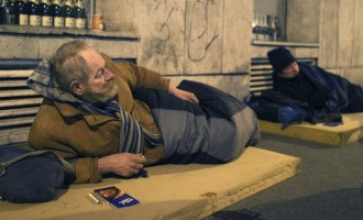 Two homeless men lie on mattresses in central Budapest in 2010