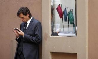Man Looking at iPhone