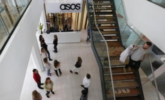 New employees wait in the lobby on their first day of work at the ASOS headquarters in London April 1, 2014.