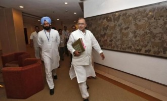 India's Finance and Defence Minister Arun Jaitley (C)