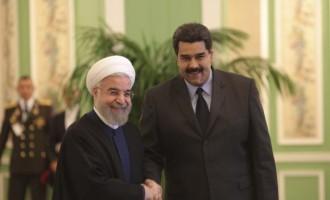 Venezuela's President Nicolas Maduro (R) and Iran's President Hassan Rouhani