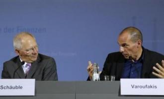 Greek Finance Minister Yanis Varoufakis and German Finance Minister Wolfgang Schaeuble (L)