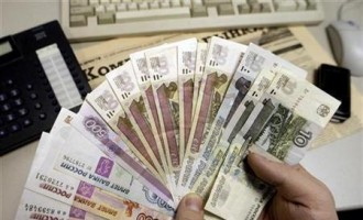 A person holds Russian rouble notes