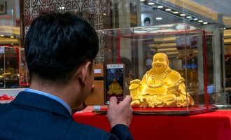 Chinese consumers are taking pictures of a gold Maitreya...