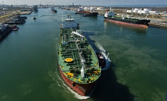 Views Of Tankers & Refineries As Oil Trades Near 12-Year Low