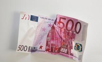 Crumpled 500 euro banknote.