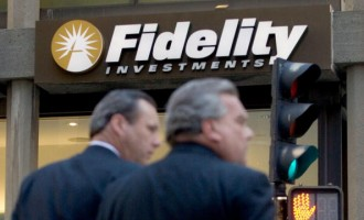 Pedestrians pass a Fidelity Investments office in Boston, Ma