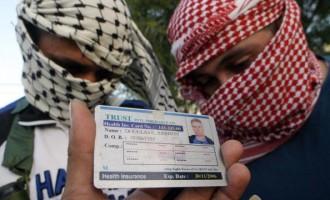 Militants show off a health insurance card