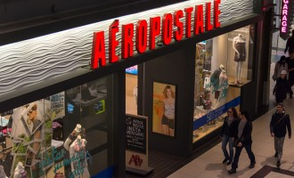 Shoppers passing by Aeropostale retail store inside a mall,...