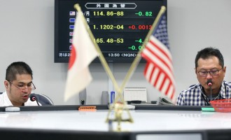 Images Of Currency Rates And Stock Exchange Boards As Global Stock Rout Extends to Japan